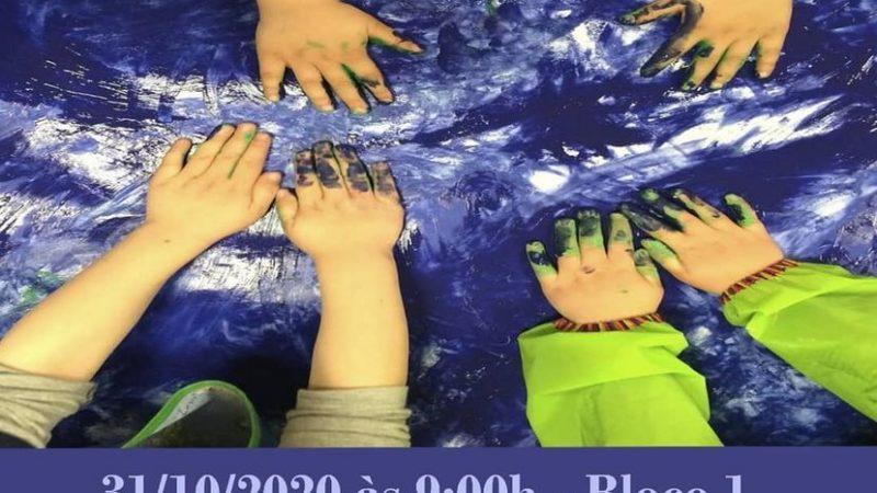 Crianças pintando uma tela com as mãos e detalhes do dia do evento